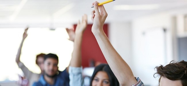 hands up for questions in a classroom